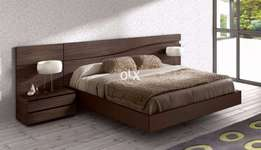 selling new fancy double bed with two side table.