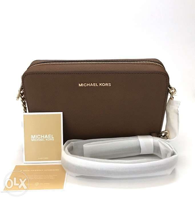 727ad622f2f2 AUTHENTIC Michael Kors Jet Set Crossbody Bag in Luggage Brown Leather ...