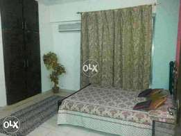 Homely environment completely furnished room attached bath with cupboa