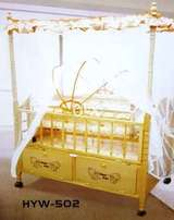 Wooden baby cot with mosquito net