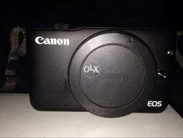 canon m10 with lens in warranty