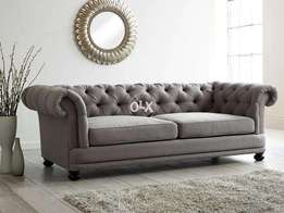 Grey chesterfield sofa in round arms