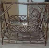 Canewood cot in good condition