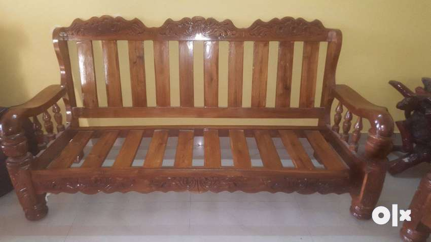 An Assam Teak Wood Sofa 5 Seater With A Strong Beds