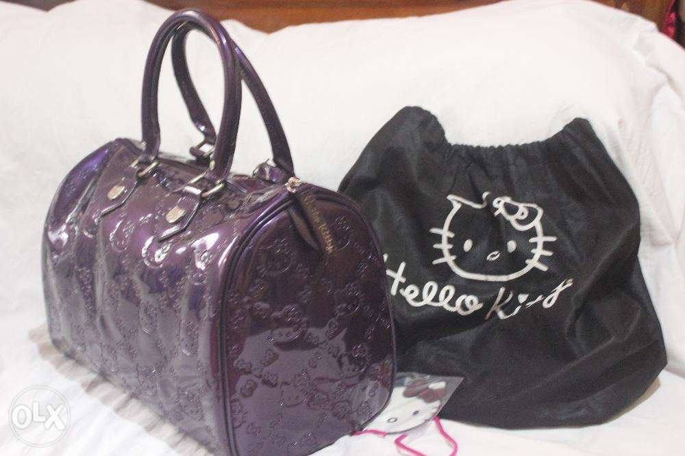 b9b453610175 ... Hello Kitty Loungefly Purple Patent Embossed City Tote Large ...