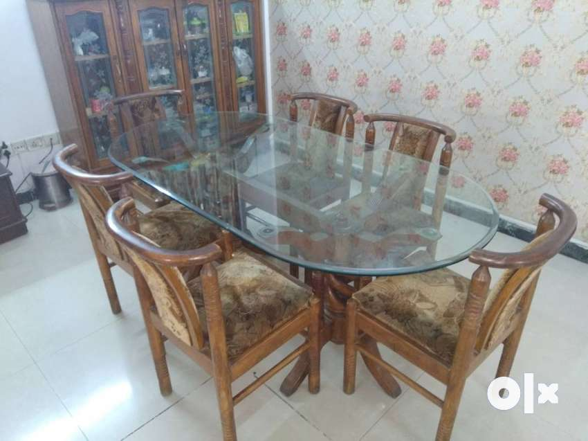 Oval Shaped Dining Table With 6 Chairs Of Carved Teak Wood