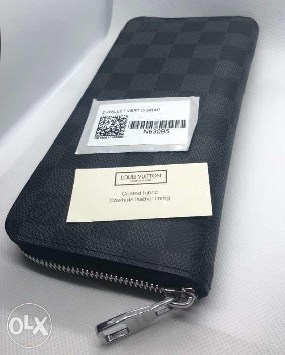 6b99d4e40aa4 Authentic LV Zippy Vertical Damier Graphite Long Wallet Louis Vuitton ...