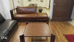Four seater light brown leather sofa with center table export quality