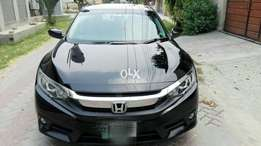 99.99% genuine Full option UG civic 1.8