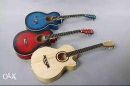 Three Red, Blue,and Beige Acoustic Guitar