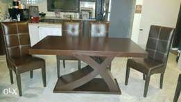 New wooden top X style table | six chairs full cushion.