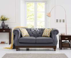 Grey chesterfield Sofa in leather.