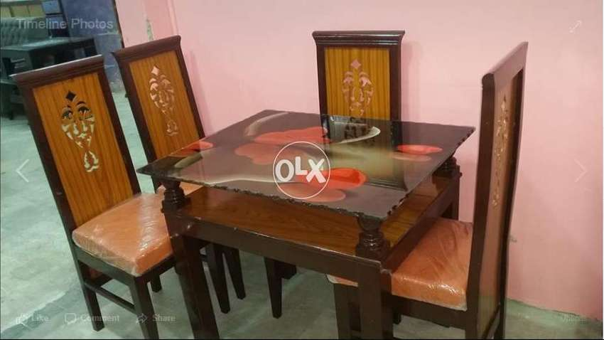 A Cuty Dining Table With 4 Chairs At Company Price