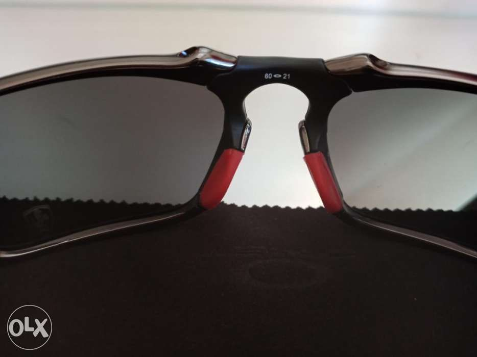 72e51cf714 ... Oakley Badman Dark Carbon with Black Iridium Polarized Lens ...