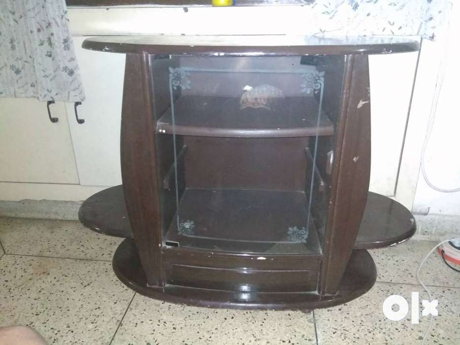 Show Only Image. TV Table Cum Showcase With Wheels.