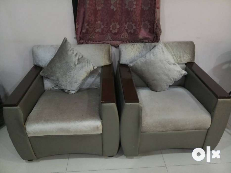 Show Only Image. Two Gray Suede Sofa Chairs