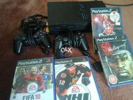 Playstation 2 in good condition working with cd and 2 cantroler