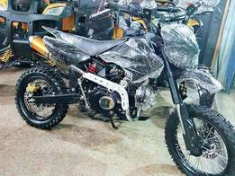 Black trail bike 48 cc manual for sell at ABDULLAH ENTERPRISES Lhr.