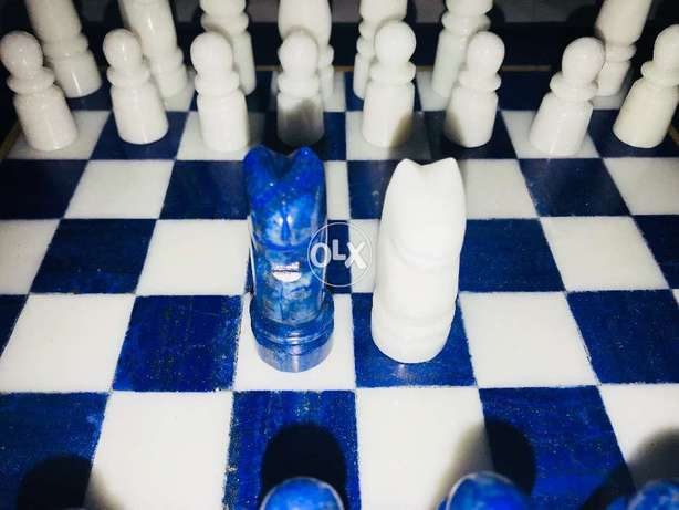 Beautiful chesss set made completly of lapis lazuli and white marble
