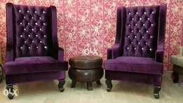 Pair of high back chairs in imported shaineel fabric.