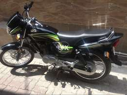 Honda deluxe in genuine condition just call no sms