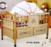 Wooden baby cot with net