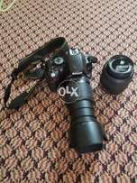 Nikon D5100 with two lenses.