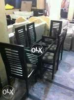 6 seater wooden dinning table with glass top