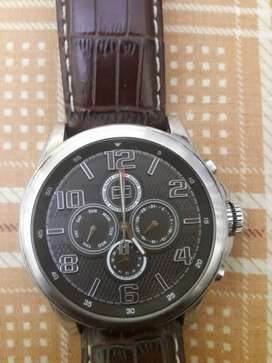 1126dc3e401b45 Tommy Hilfiger Round Silver Analog Watch With Brown Leather Strap.