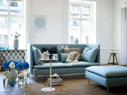 High back Sofa with pouffe.