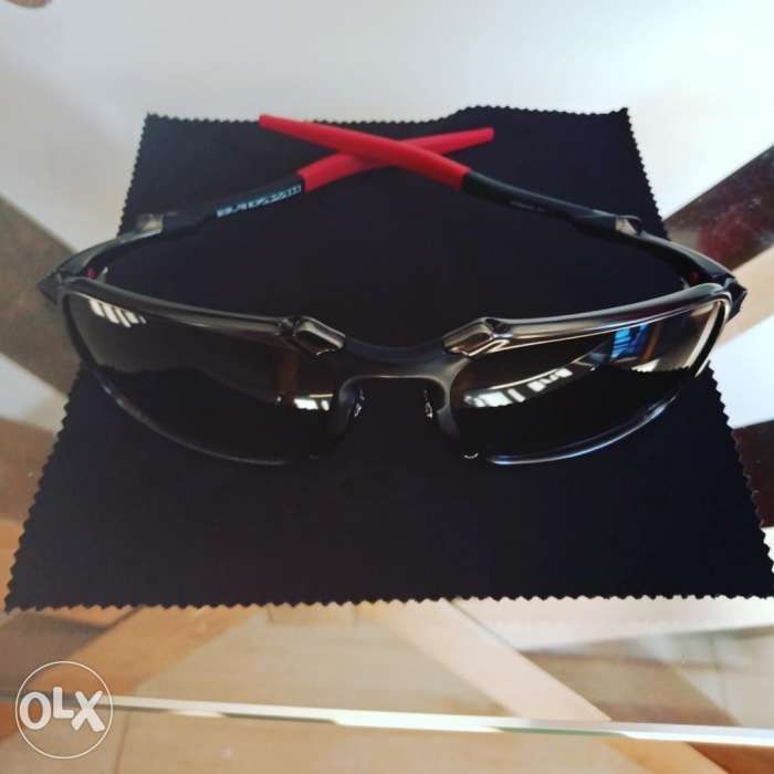 f859dc1f04 Oakley Badman Dark Carbon with Black Iridium Polarized Lens in ...