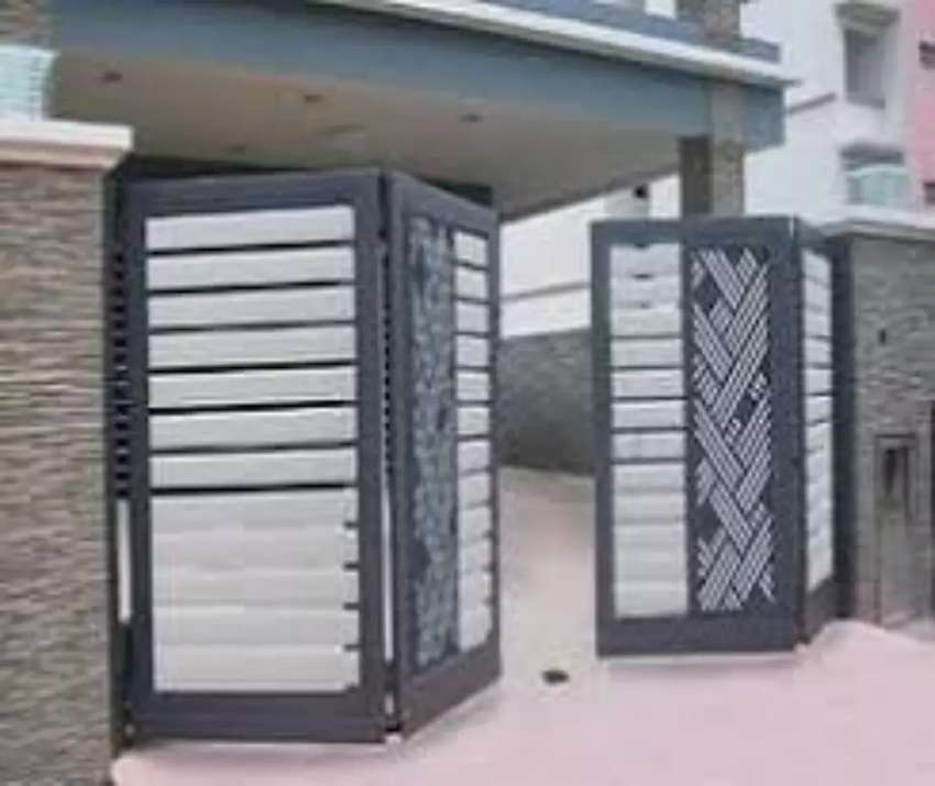 Pintu Lipat Pintu Garasi Pagar Besi Kanopi Minimalis - Konstruksi Dan Taman  - 781538121