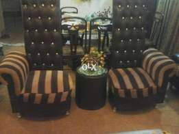 Stylish leather and cloth high back sofa set in excellent condition.