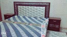 King size bed with 2 side tables.. Without matress