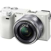 Sony A6000 Mirrorless DSLR Camera and16-50mm Lens in white bought USA