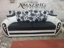 New Black and white sofa set seven seater in leatheright.