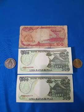 uang kuno 100 kertas dan logam . uang 1000 kelapa sawit . uang 500