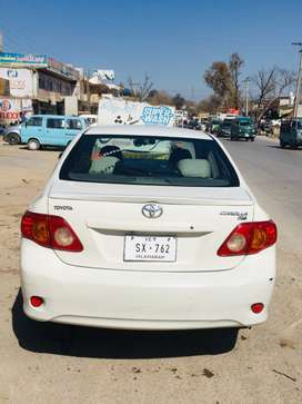 Corolla Xli 2010 in white colour