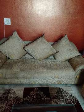 Seven seated sofa with cushions