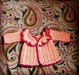 A sweater for new born baby