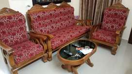 wooden sofa set with table.