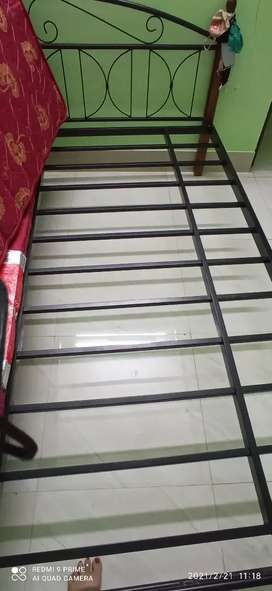 Iron double bed in good condition.
