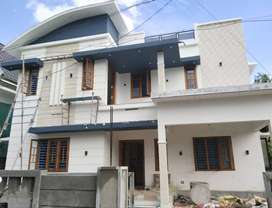 AN ELEGANT NEW 4BED ROOM 5CENTS 2000SQ FT HOUSE IN MUNDOOR,THRISSUR