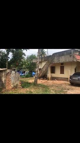 34.5cent rectangular plot with single storeyed house