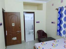 Dulexe room with attached bathroom