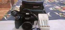 Sony digital still camera with batteries and battery charger.