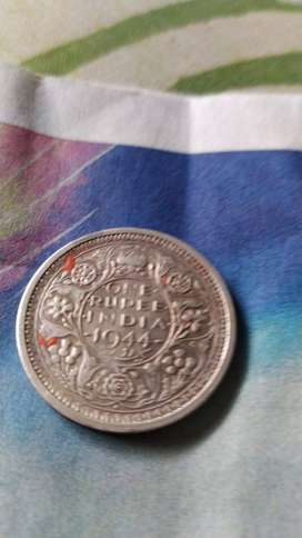 Old one rupee coin.
