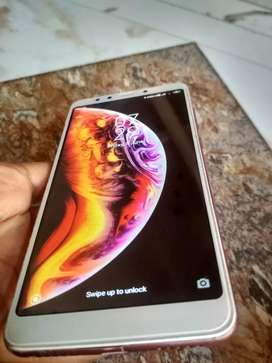 1 year old. Great condition,, Redmi 5 rose gold with bill