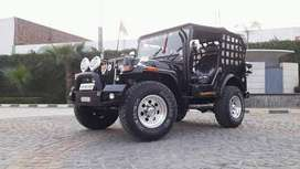 Black wilys jeep with side tool box