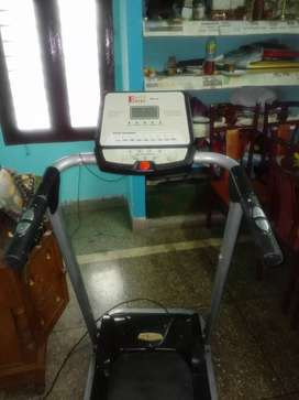 Excel brand tread mill  nd Samsung TV with tablefor sale